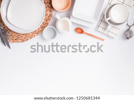 Different tableware and dishes on the white background, top view. Kitchen accessories flat lay. #1250681344
