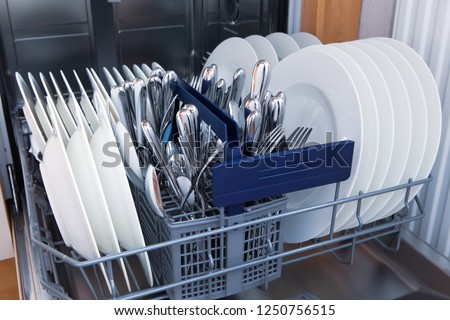 opened dishwasher with clean dishes #1250756515