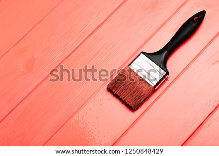 Living Coral fresh painted wooden board. Renovation concept. Top view. Color of the year 2019. Renovation concept. #1250848429