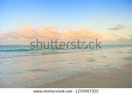 Beautiful sunset hour landscape of Bavaro Beach at Dominican Republic, with the Caribbean Sea, blue sky and and amazing warm sunset clouds. #1250987302
