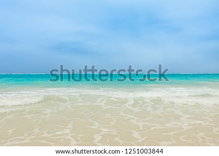 Beautiful landscape of Cap Cana Beach at Dominican Republic, with perfectly divided line of the Caribbean Sea and the blue sky.  #1251003844