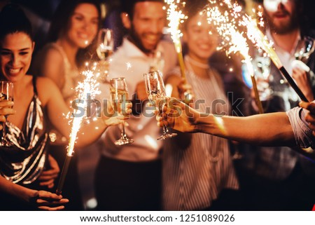 Group of friends toasting in the club #1251089026