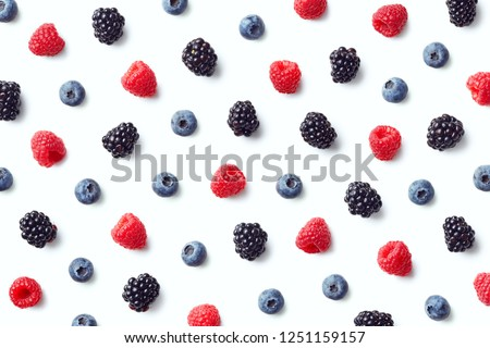 Fruit pattern of colorful wild berries isolated on white background. Raspberries, blueberries and blackberries. Top view. Flat lay #1251159157