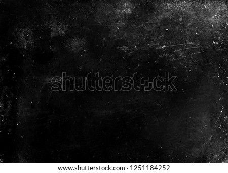 Black grunge scratched scary background, old film effect, dusty texture #1251184252
