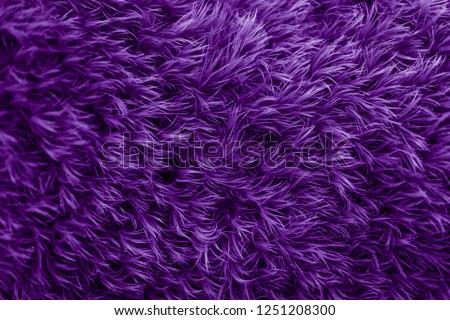 Purple fur texture. Violet glamorous background.   Royalty-Free Stock Photo #1251208300