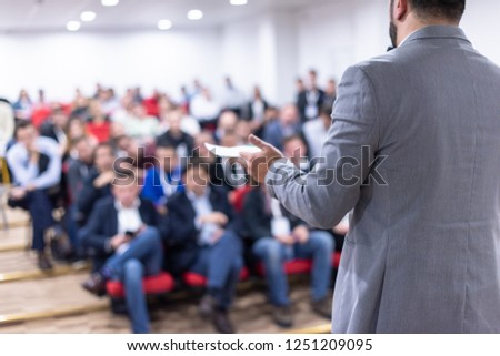 young businessman at business conference room with public giving presentations. Audience at the conference hall. Entrepreneurship club #1251209095