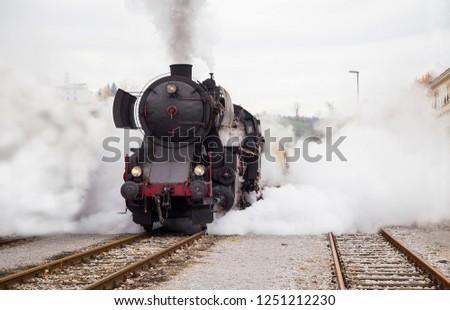 Old Steam train - locomotive is leaving the Railway Station at Nova Gorica, Slovenia, Europe #1251212230