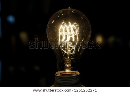 old light bulb glowing in dark . Close up #1251252271