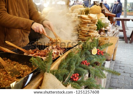Cracow/Krakow/Poland - 6 December 2018: Traditional Polish round bread at a Christmas Market stall in Krakow, Poland. Traditional Polish street food.                            #1251257608