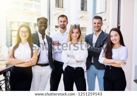 Group portrait of professional business team looking confidently at camera #1251259543
