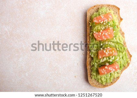 Toast with avocado and red fish in sesame on neutral background. Top view. #1251267520