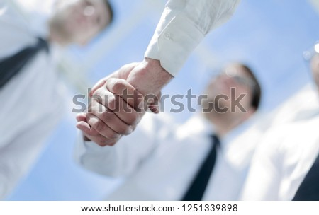 business background.handshake business partners #1251339898