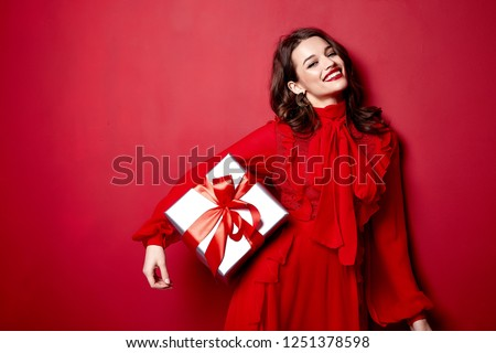 Beautiful young sexy woman thin slim figure evening makeup fashionable stylish dress clothing collection, brunette, gifts boxes red silk bows holiday party birthday New Year Christmas Valentine's Day. #1251378598