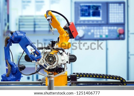Industrial robotic welding and robotic 3D scan working with engine parts on smart factory, on blurred control panel blue tone background, industry 4.0, smart automation working on teamwork concept. #1251406777