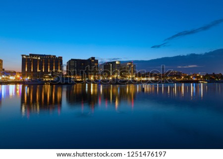 WASHINGTON DC, USA - JULY 28, 2018: US capital Wharf designed as a broad promenade with new living, shopping and entertainment venues. The Wharf of Washington DC at night. #1251476197