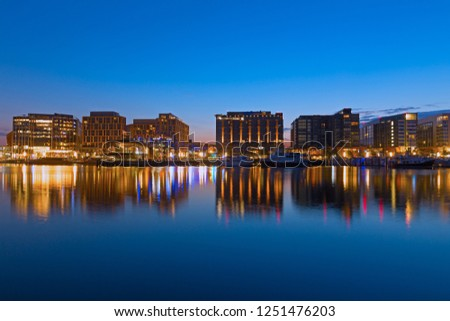 WASHINGTON DC, USA - JULY 28, 2018: The Wharf of US capital at night.  It is located along the Washington Channel, just south of the National Mall and west of the newly developed Capitol Riverfront. #1251476203