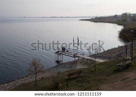 Man fishing fish in a lake #1251511159
