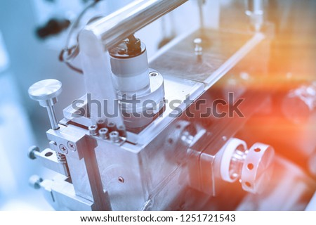 plant picture, manufacture, steel chrome machines. Blue tone. Blue tint