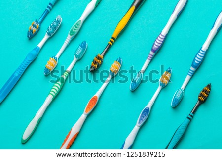 Toothbrushes on blue background #1251839215