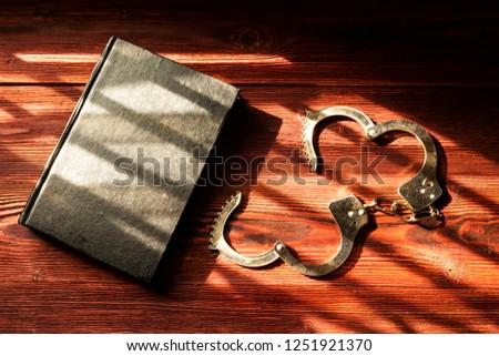 Handcuffs and the Holy Bible. Concept Picture of Someone Who Released From Sin by the God Words.