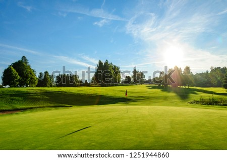 nice evening scenery on a golf course #1251944860