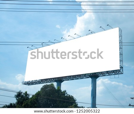 Blank billboard on blue sky background for new advertisement #1252005322