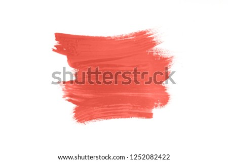 Living coral color abstract brush stroke isolated on white. Color of the 2019 year. #1252082422
