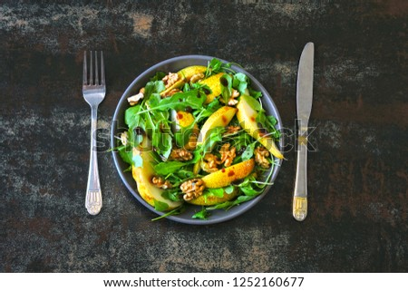 Healthy colorful salad with arugula and pear. Top view. Flat lay. #1252160677