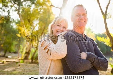 Happy Middle Aged Caucasian Couple Portrait Outdoors. #1252173376
