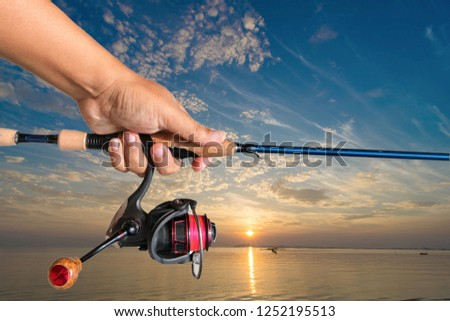 Fishing rods  handle  Hold on the white background. #1252195513