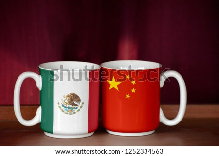 China and Mexico flag on two cups with blurry background #1252334563