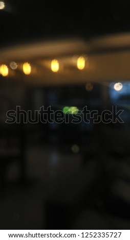 Bokeh background of night lamp in cafe or fancy coffee shop interior  #1252335727