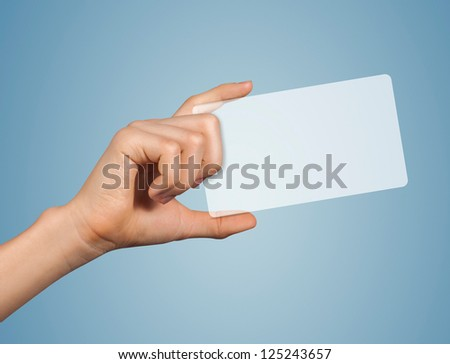 Modern transparent blank card in a hand