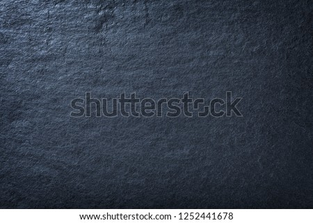 Navy blue background of natural slate. Texture of stone closeup. Graphite backdrop macro #1252441678