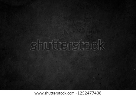 Black grunge background. Chalkboard texture. Blackboard wallpaper