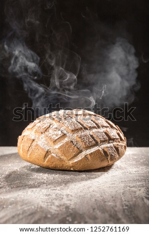 March 18, 2015 Hot Steamed homemade flour and bread in studio shot on black background #1252761169