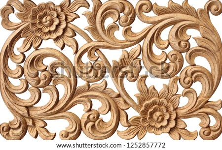 Pattern of flower carved on wood isolated on white background. Royalty-Free Stock Photo #1252857772
