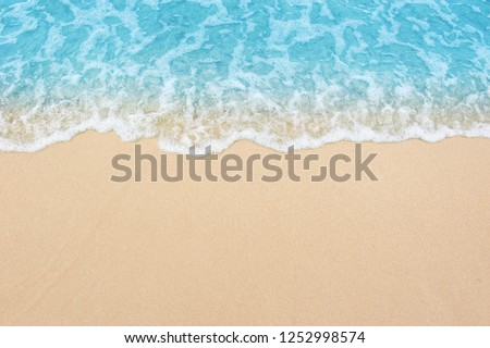 beautiful sandy beach and soft blue ocean wave  #1252998574