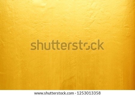 Old Grunge Golden Painting on Wood Wall Background with Light Leak on Top. #1253013358