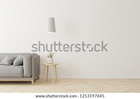 Interior of living room modern style with grey fabric sofa,wooden side table and white ceiling lamp on wooden floor. #1253197645