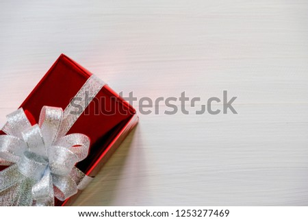 Christmas and Happy new year composition, Christmas  red present gift boxes with silver ribbon on wooden white background. Flat lay, top view, copy space. #1253277469