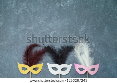 Carnival and New year party background with carnival masks photo booth props. Top view from above