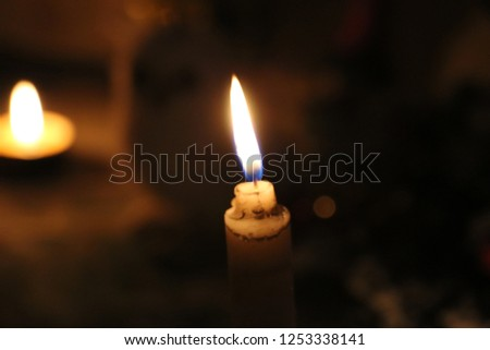 warm candle's flame #1253338141
