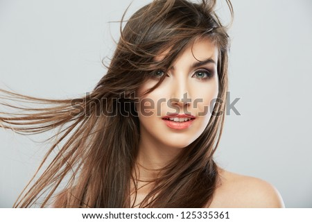 Woman face with hair motion on white background isolated close up portrait. #125335361