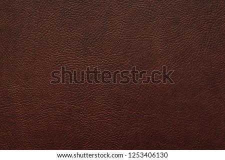 Elegant dark brown leatherette background. Dermantin texture. Free space for text.
