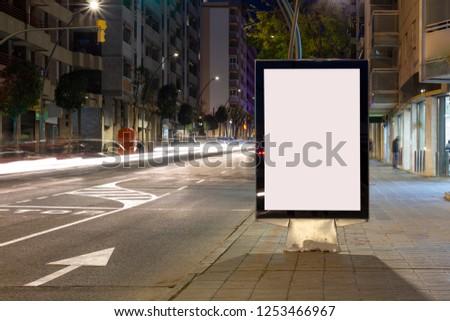 Blank advertisement billboard, with blurred traffic lights at night #1253466967