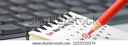 image of calendar and pencil closeup #1253510374