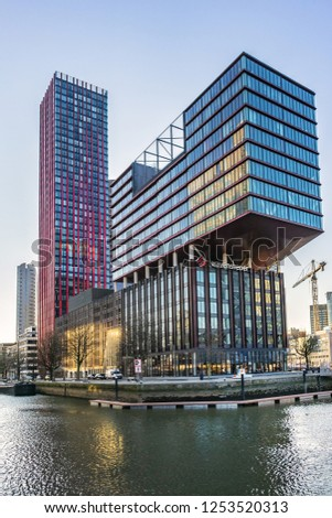 ROTTERDAM, THE NETHERLANDS - FEBRUARY 23, 2018: Embankment in Rotterdam Wijnhaven at sunset. The Wijnhaven district in Rotterdam is designated as a high-rise area for residential towers. #1253520313