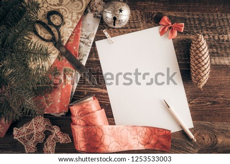 Christmas wish list for Santa. Top-down view on a blank letter on the wooden table. #1253533003