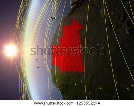 Mauritania from space on model of Earth during sunset with international network. Concept of digital communication or travel. 3D illustration. Elements of this image furnished by NASA. #1253552194